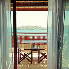 Open balkony with furniture and sea view(Crete, Greece).