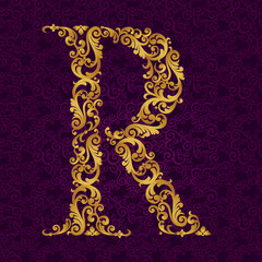 Gold font type letter R, uppercase.