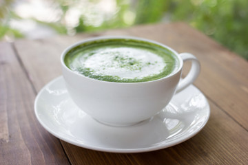 Matcha green tea latte beverage in glass.