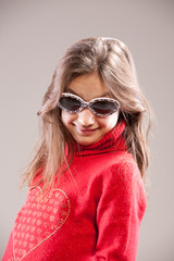 little girl playing as a fashion model with sunglasses