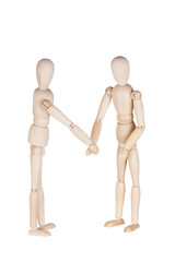 Two wooden dummies represent friendly handshake or a greeting