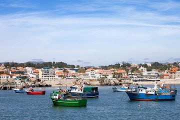 Fishing Boats and Cascais Coastline in Portugal