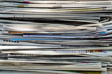 Closeup of a pile of newspapers