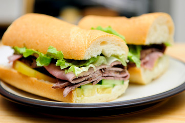deli style roast beef sliced on a submarine roll with heirloom t