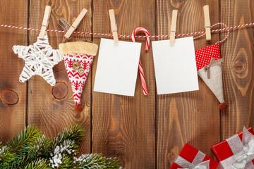 Snow fir tree, photo frames and christmas decor on rope