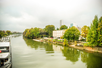 river Seine with docking boats and forest .,Paris. France.