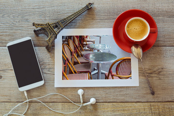 Photo of restaurant in Paris with coffee and smart phone