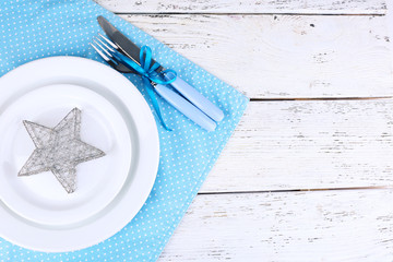 White plates, fork, knife and Christmas decoration