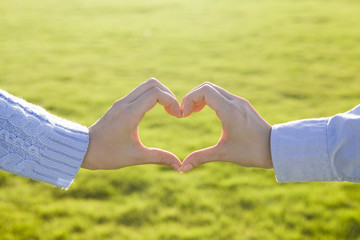 Two hands in the shape of heart