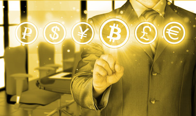 Choosing bitcoins, businessman pressing touch screen button.