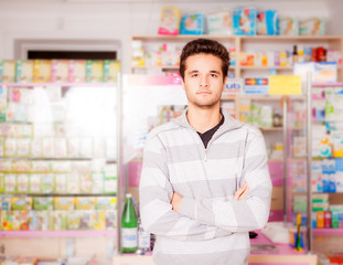 Handsome guy in front of pharmacy stand