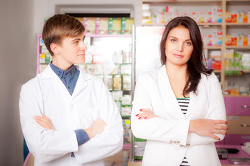 Druggist and client in front of pharmacy table