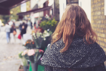 Woman outside a florist