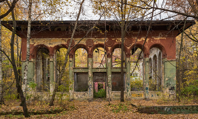 Facade of old abandoned ruins in the forest
