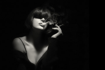 Smoke. Beauty Fashion Model Smoking a Cigarette