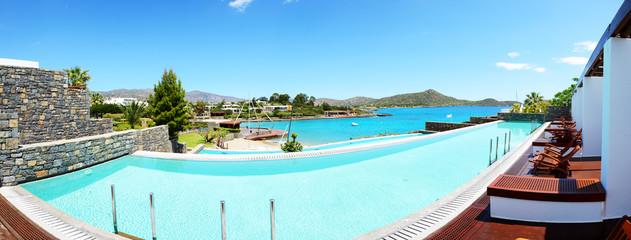 Panorama of swimming pool at luxury hotel, Crete, Greece