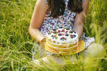 Girl with blueberry cake