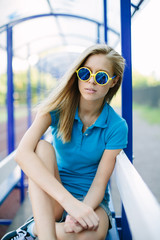 Beautiful girl sitting on a park bench