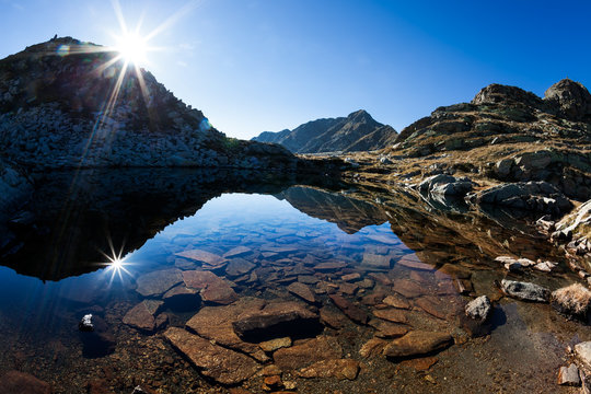 Small mountain lake in a sunny autumn day in italian Alps