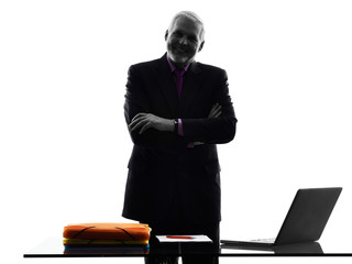 senior business man standing arms crossed smiling silhouette