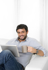 young man relax with coffee using online digital tablet pad