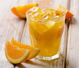 Orange juice  with ice on   wooden background