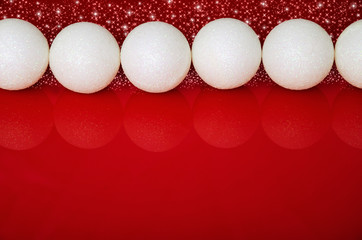 Christmas balls in a row and red space for text