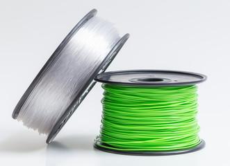 Fototapeta Filament für 3d Drucker glasklar und hellgrün vor hellem Hinte obraz