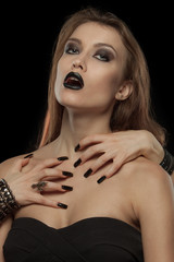 Gothic woman with hands of vampire on her body
