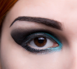 Close-up shot of an eye with artistic makeup