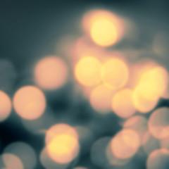 Dark Night Christmas background with bokeh lights. Defocused Bok