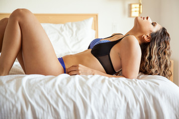 Sexy girl lying on a bed
