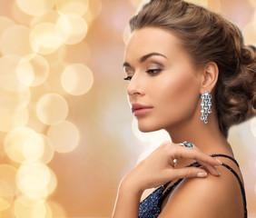 beautiful woman wearing ring and earrings
