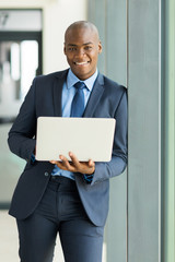 young african american business man with laptop
