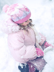 Child playing with snow.