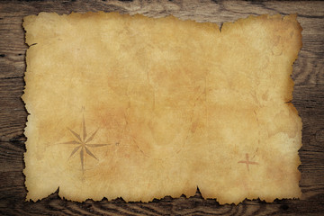 Pirates' old parchment treasure map on wood table