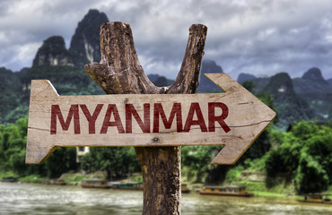 Myanmar wooden sign with agricultural background