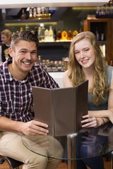 Young couple discussing the menu