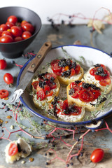 mediterranean bruschetta with cherry tomatoes, olive and thyme