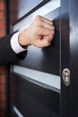 Salesman knocking on the door