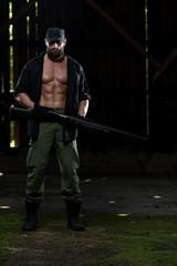 Portrait Of A Man With Machine Gun