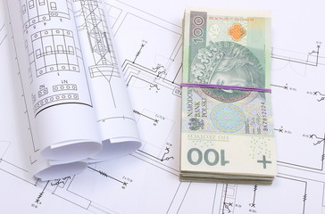 Banknotes, electrical diagrams on construction drawing of house