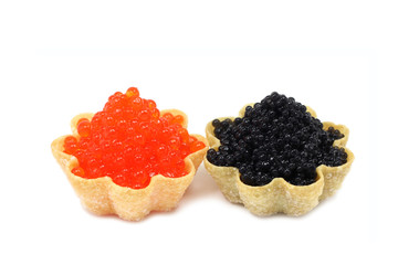 two tartlets with black and red caviar on white background