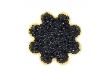 a little black caviar in tartlets on white background
