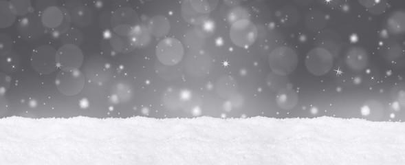 Bokeh Hintergrund mit Schnee / Weihnachtlich
