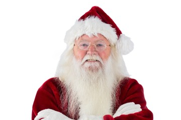 Santa smiles with folded arms