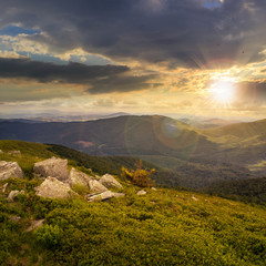 boulders on mountain top at sunset