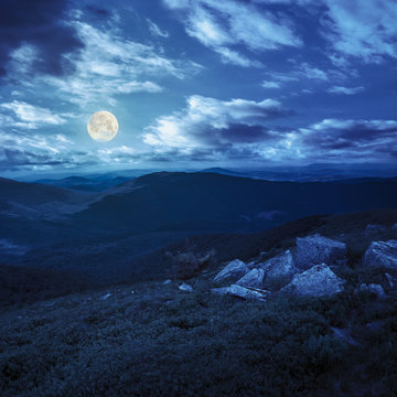 boulders on mountain top at night