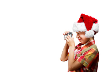 Funny little child dressed as Santa taking photo with camera