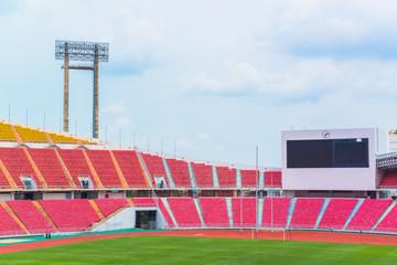 stadium, red seats on stadium steps bleacher